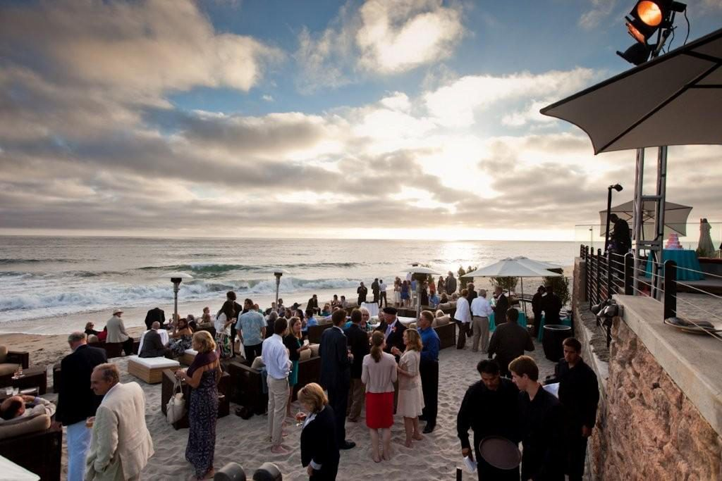 Enjoying the surf and sand at a very special wedding planned to perfection by The Party Link!